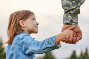 PTSD Veterans Image - soldier holding daughter's hand